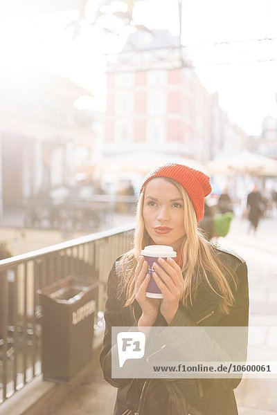 Young women with takeaway coffee  Covent Garden  London  UK