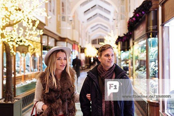 Young couple shopping in Burlington Arcade at xmas  London  UK