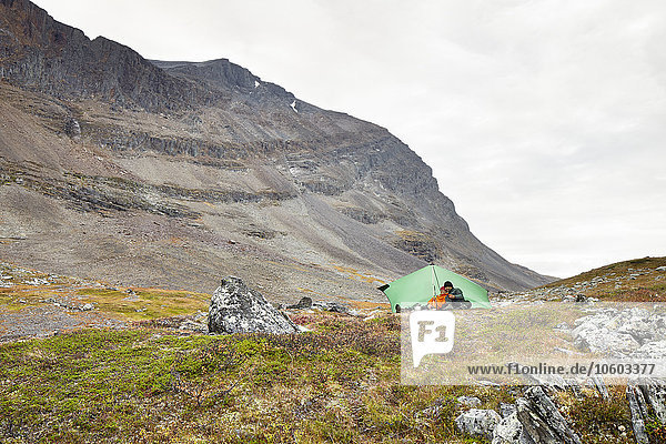Couple camping in mountains