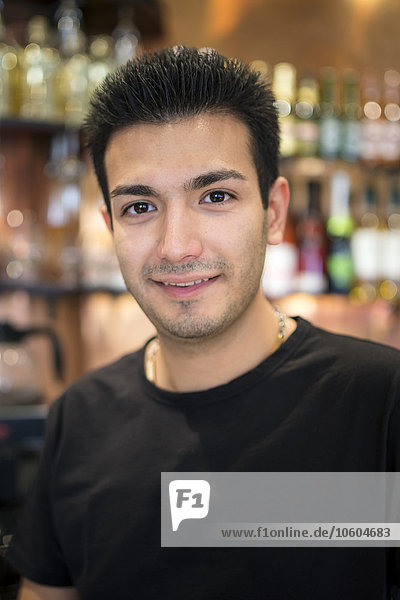 Portrait of young man in bar