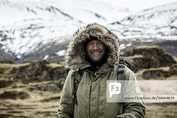 Smiling man in mountains