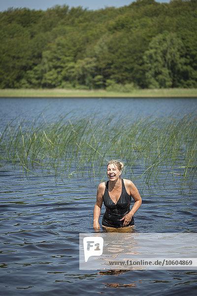 Smiling woman in lake