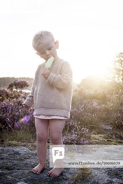 Small boy eating ice-cream