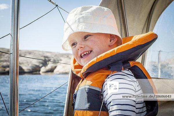 Smiling boy wearing life jacket