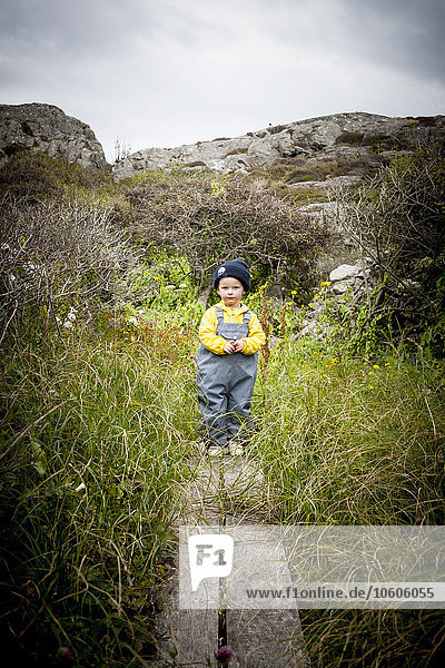 Small boy standing on pathway