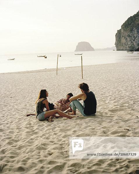 Friends on a beach  Thailand.