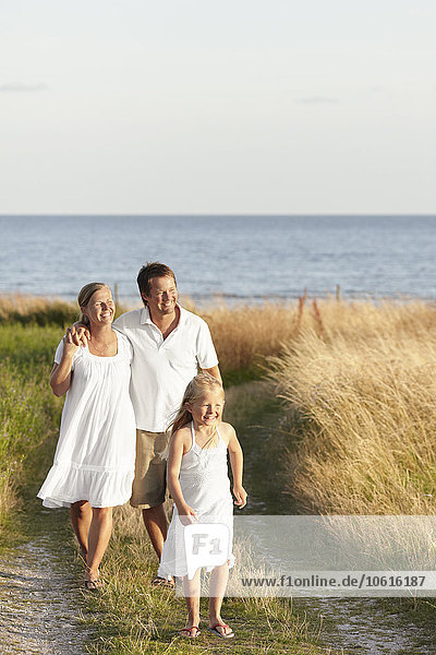Family walking at sea