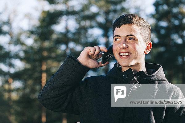 Portrait of teenage boy talking on his mobile phone