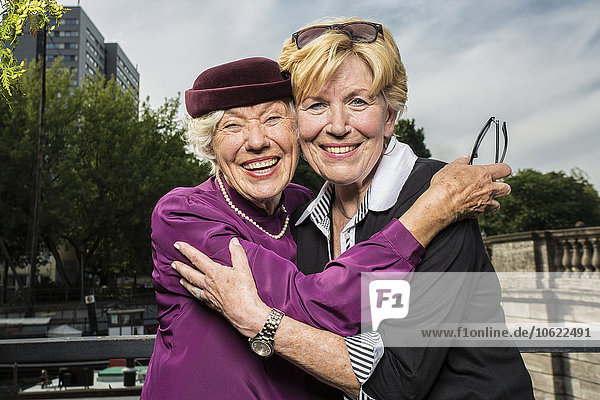 Germany  Berlin  portrait of two happy senior women head to head