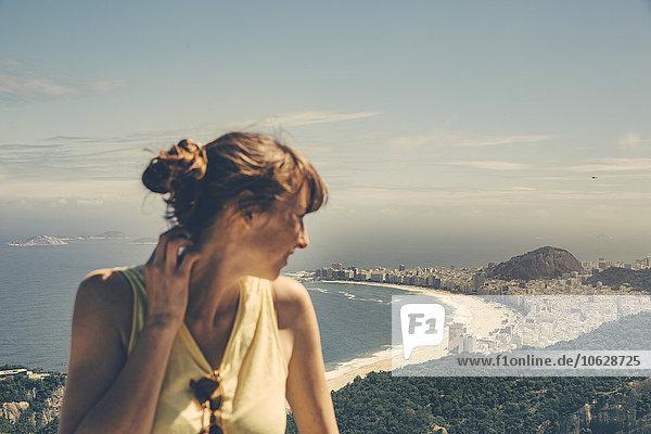 Brazil  Woman looking down onto Copacabana of Rio de Janeiro from Sugarloaf Mountain