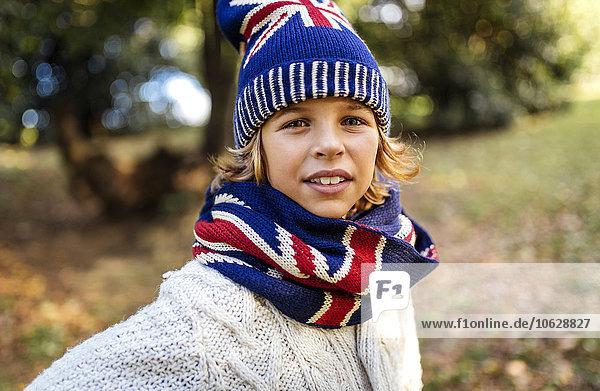 Portrait of blond boy wearing fashionable knit wear in autumn