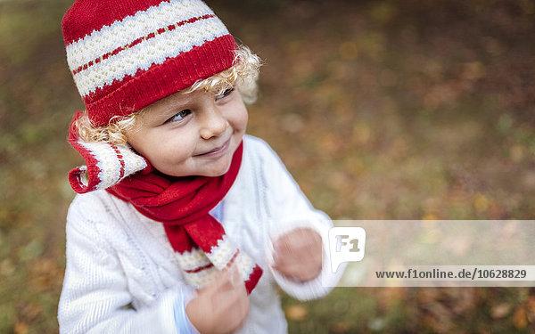 Portrait of blond little boy wearing fashionable knit wear in autumn