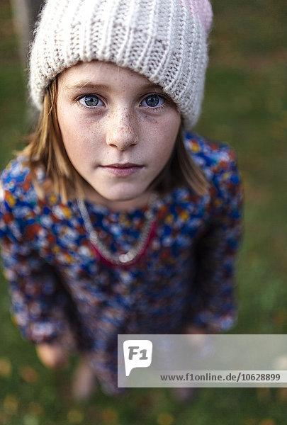 Portrait of serious looking girl wearing woollen cap