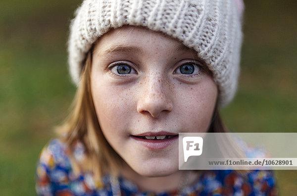 Portrait of smiling girl wearing woollen cap