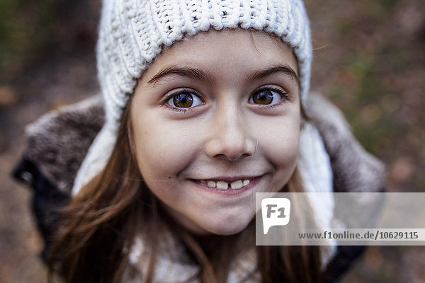 Portrait of smiling girl wearing wooly hat