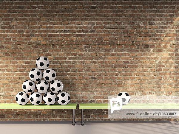 Stapel und ein einzelner Fußball auf Bänken im Umkleideraum  3D Rendering