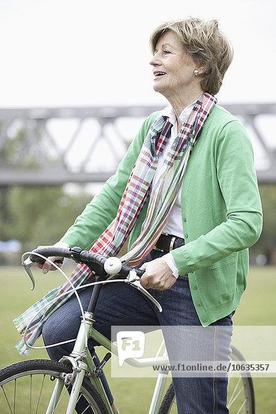 Mature woman cycling bicycle