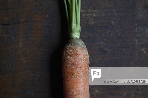 Close-up of carrot on wooden table