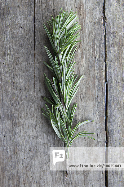 Close-up of rosemary on wooden table
