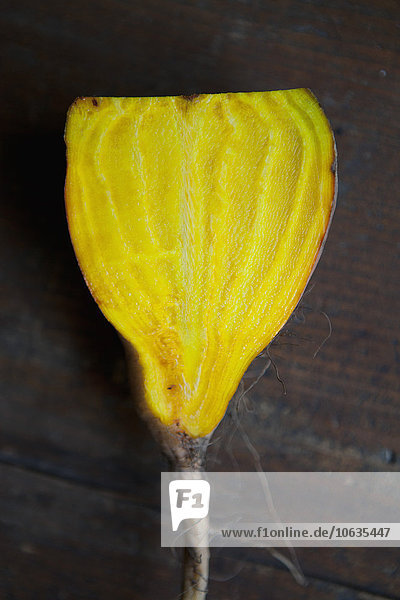 Close-up of yellow beet on table