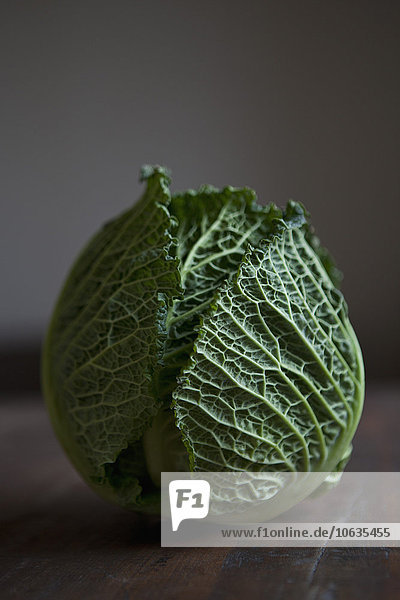 Savoy cabbage on table