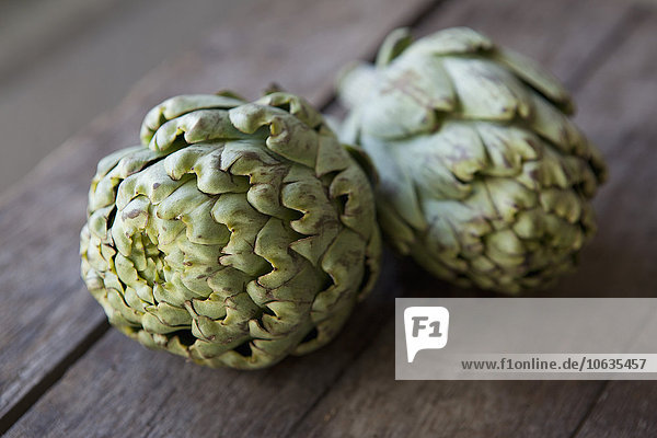Close-up of artichokes on table
