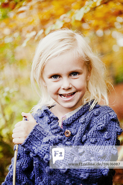 Portrait of smiling girl in forest