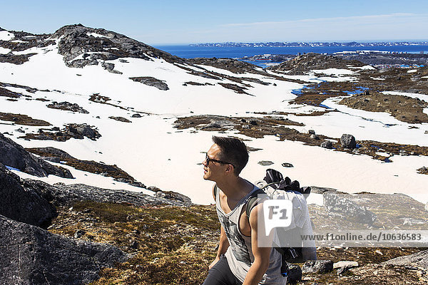 Hiker walking on snow covered mountain
