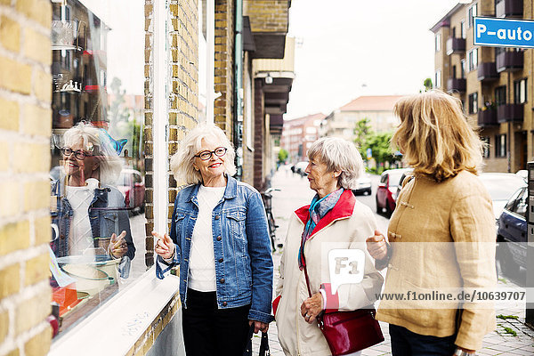 Senior women doing window shopping
