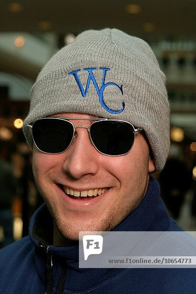 Portrait of an adult wearing sunglasses and smiling in a generic indoor environment  all model released ( MR_050212_1 to MR_050212_61).