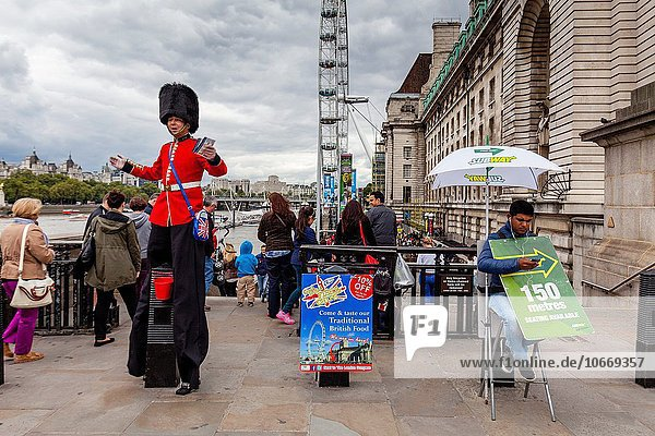 A Man Dressed In A Guards Uniform Hands Out Leaflets and Poses For Photographs With Tourists  Westminster Bridge  London  England.