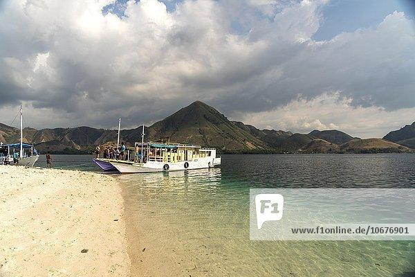 Excursion boats  beach  island of Kelor  edge of Komodo National Park  Lesser Sunda Islands  Indonesia  Asia