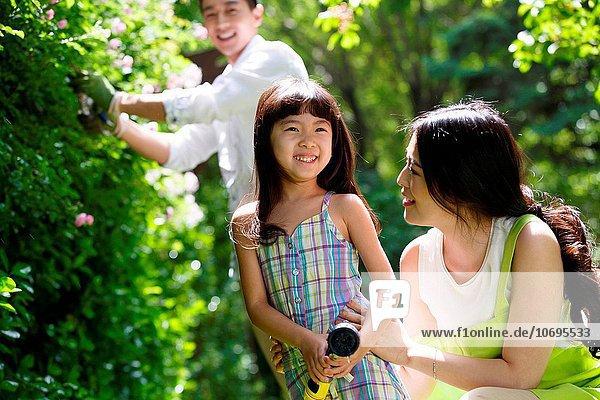 A happy family in the garden three