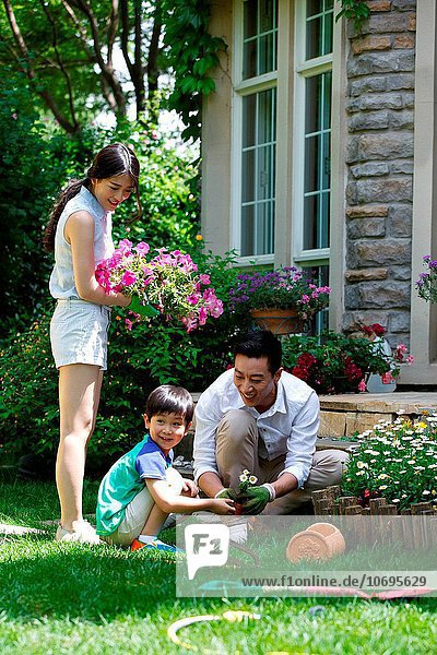 The happiness of a family of three in the flowers