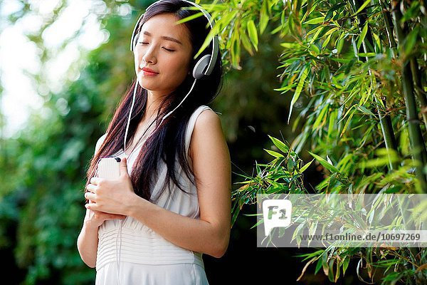 Young women listen to music