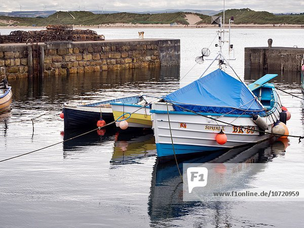Fishing Boats Moored in the Harbour at Beadnell Northumberland England.