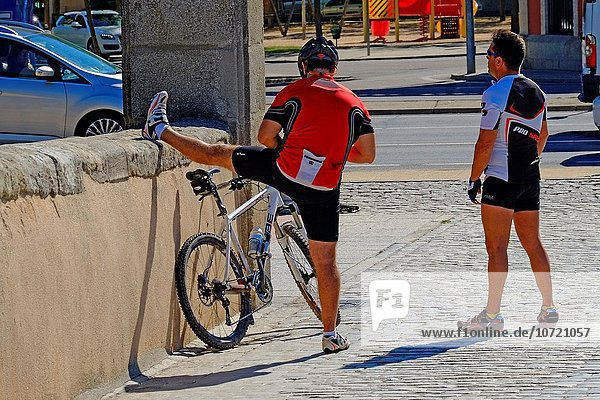 Bicyclist Stretching Salamanca Spain ES.