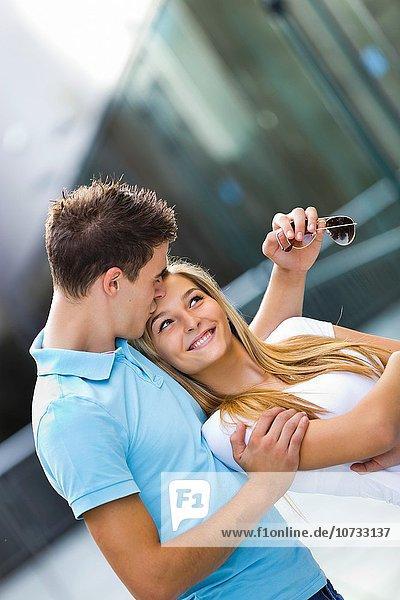 Teen couple girl and boy happy kiss on forehead