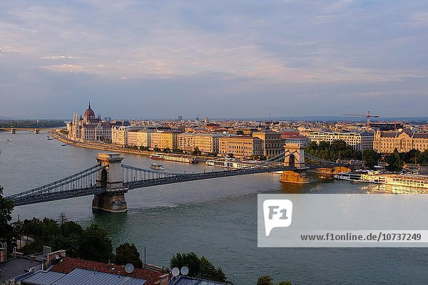 View of Pest  the Danube river and the Chain bridge  Széchenyi hid  from the Buda Castle  Budapest  Hungary  Europe