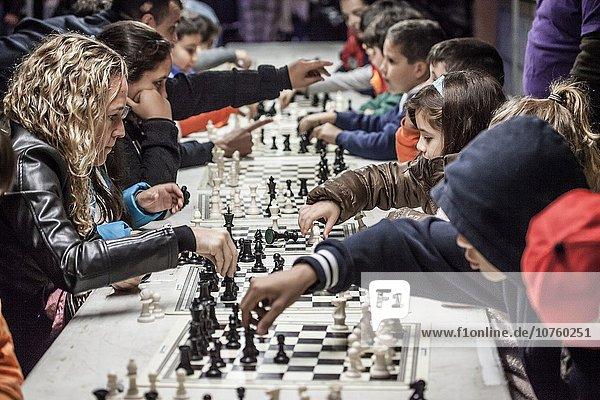 people playing chess during the LA NOCHE EN BLANCO event in San Cristobal de La Laguna