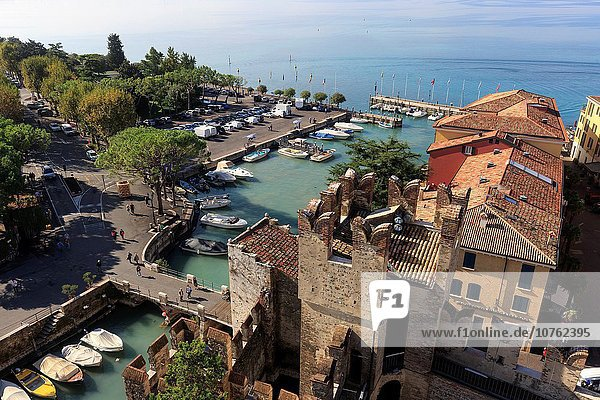 View from the old town with marina on Scaligerburg  Sirmione  Lake Garda  province of Brescia  Lombardy  Italy