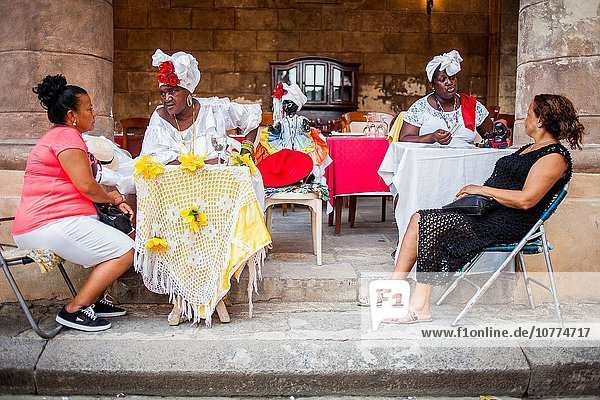 Cuban priestesses of the Afro-Cuban Santeria religion telling the future and fortune to their clients  in Plaza de la Catedral Old Havana  Habana Vieja  La Habana  Cuba.