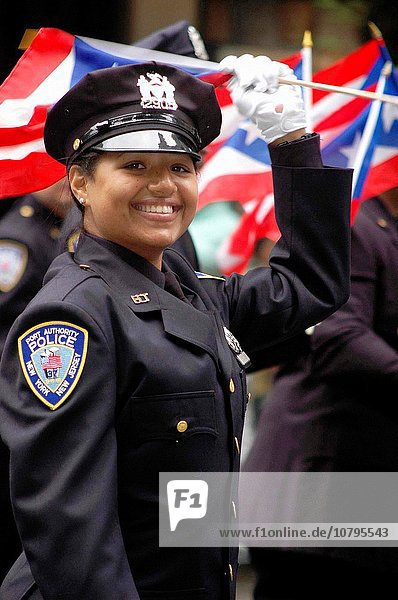 USA  New York  New York City  Police Woman  of Puerto Rican Origins  at the Puerto Rican Parade along the Fifth Avenue.