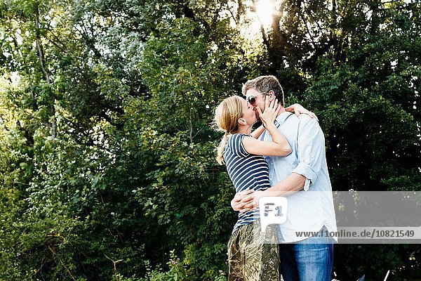 Couple sharing passionate kiss in park