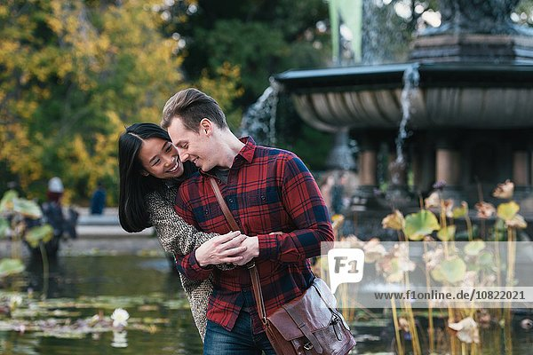 Mid adult couple holding hands at Bethesda fountain in Central Park  New York  USA