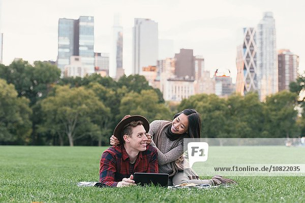 Mid adult couple on picnic blanket in Central Park  New York  USA