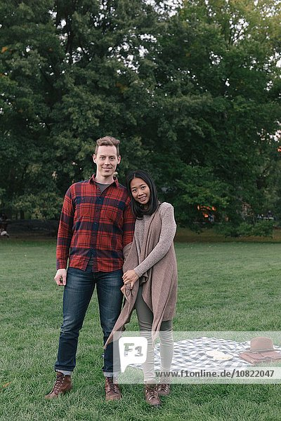 Portrait of romantic mid adult couple in park
