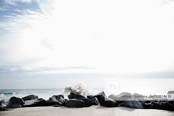 Rocks acting as breakers on Palm Beach  Florida  USA