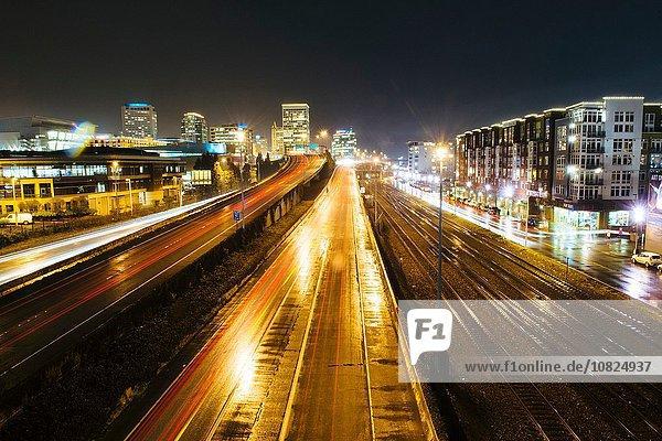 Cityscape with flyover next to rail track at night  Tacoma  Washington  USA
