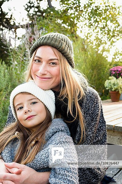 Mother and daughter wearing knitwear and hats  portrait